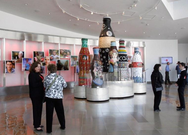 Guests check the entrance lobby area of the new World of Coca-Cola Museum in Atlanta.