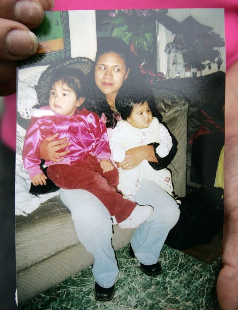 A photo shows Gilberta Estrada and two of her daughters, Janet Frayre, left, and Magaly Frayre. Estrada and three of her kids were found dead in their trailer Tuesday.