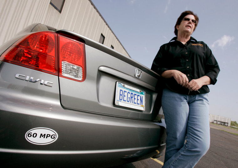 """""""When I see someone roar past me, I think, 'They just used enough gas to last me a week,""""' Laurie With says of her fuel habits. She's pictured here with her Honda Civic hybrid."""