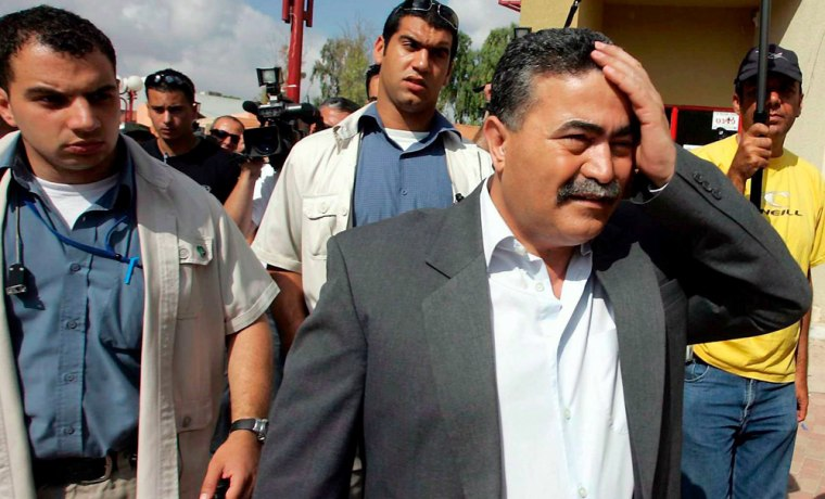 Defence Minister Amir Peretz leaves polling station in Sderot after Labor party primary vote