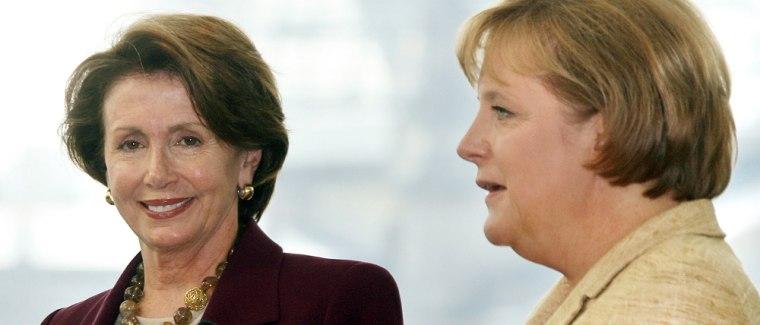 German Chancellor Angela Merkel (R) and