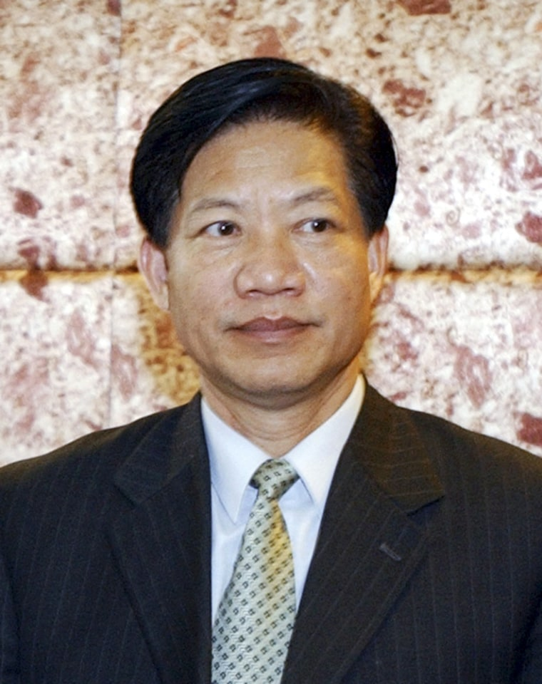 File photo of Zheng, former director of China's State Food and Drug Administration, during a meeting in Beijing