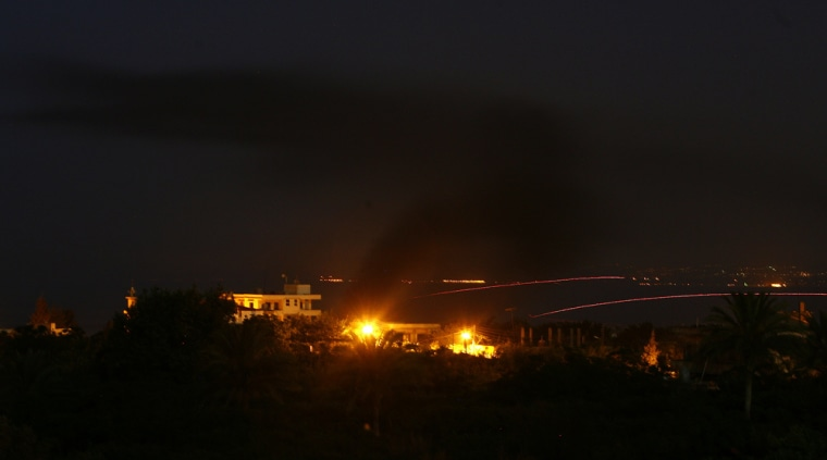 Smoke rises from a house after the Lebanese army attacked the Palestinian Nahr al-Bared refugee camp in Lebanon