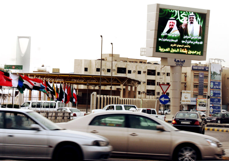A billboard showing Saudi King Abdullah bin Abd al-Aziz and Crown Prince Sultan bin Abdul Aziz, symbols of the old monarchy, abut a square with bustling traffic in downtown Riyadh. Saudi Arabia is embracing Western ideas it likes, while rejecting anything it feels could shake its conservative Islamic values.