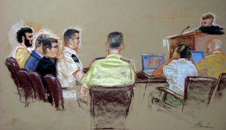 In this sketch cleared for release by U.S. military officials,detainee Omar Khadr, far left, sits flanked by three lawyers during a military tribunal arraignment at Guantanamo Naval Base on Monday.