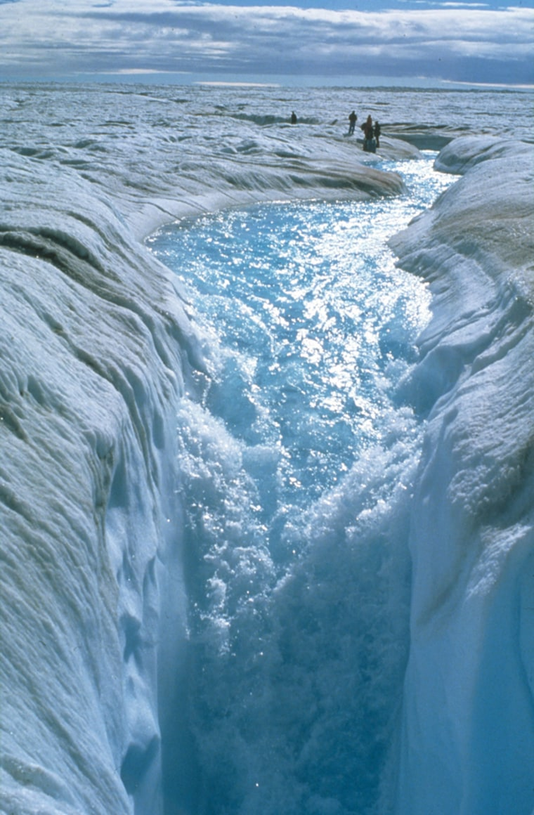 A stream of melt water cascades off the Greenland Ice Sheet.