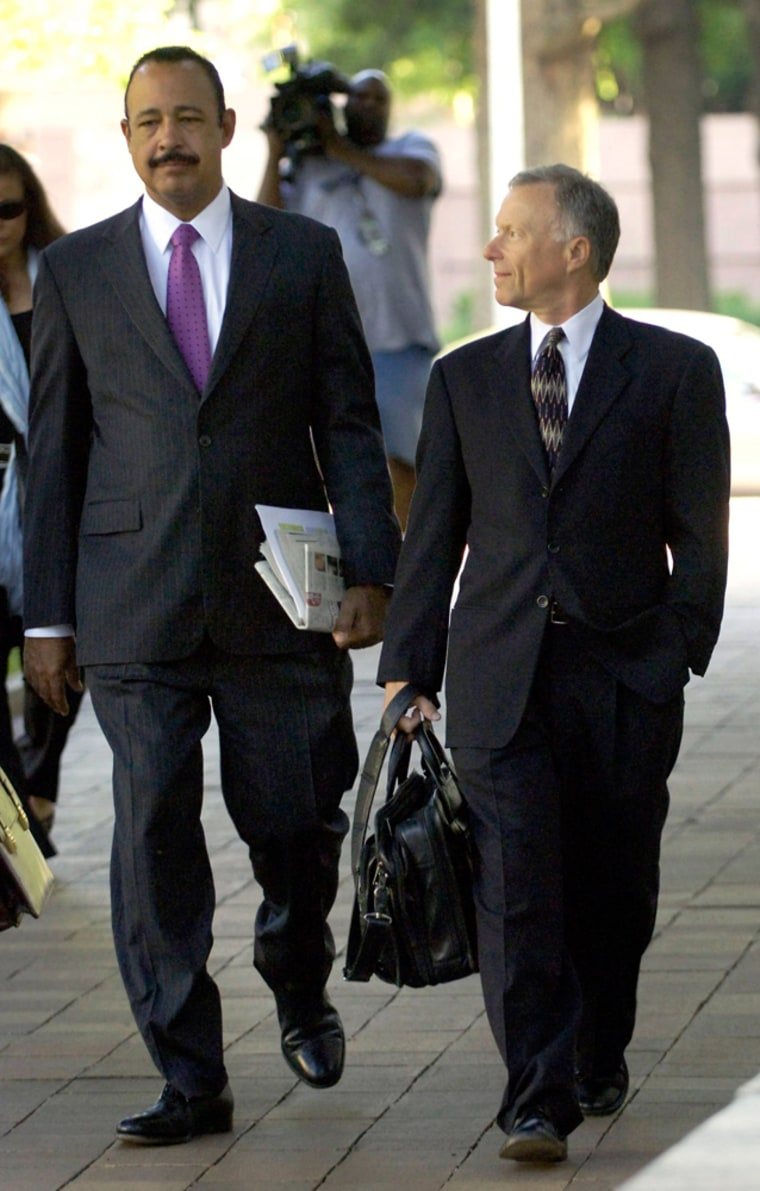 """""""Scooter"""" Libby, former chief of staff to U.S. Vice President Cheney, walks with his attorney Wells as he arrives for sentencing at a federal courthouse in Washington"""