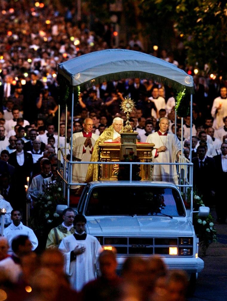 Pope Benedict XVI takes part in a Corpus Domini procession in Rome