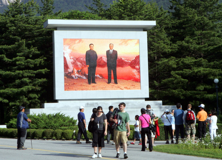 Visitors look at a portrait of North Korea's late leader Kim Il Sung, right, and currentleader Kim Jong Il at the Diamond Mountain in North Korea on June 10.