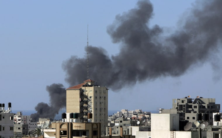Smoke bellows from a building in Gaza Ci