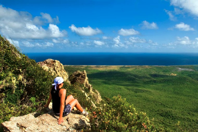 Before venturing underwater, we climb the 1,239-foot summit of Mount Christoffelin Curaçao.Jody enjoys theview from the top.