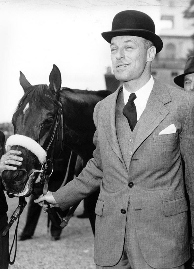 Baron Guy de Rothschild is pictured with his 5-year old filly 'Cerisoles' after it won the Prix de Diane on June 9, 1957, at Chantilly race course near Paris. Rothschild, who managed his family's French banking empire, died Tuesday his family said. He was 98.