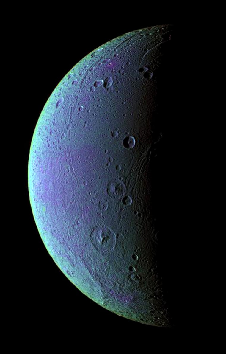 Tectonic faults and craters on Saturn's icy moon Dione are revealed in this color-enhanced image that mixes infrared, ultraviolet and green light observations. The color variations might be caused by subtle differences in the surface composition or the sizes of grains making up the icy soil, but scientists aren't sure.