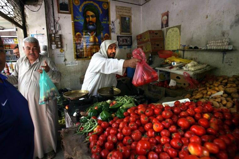 Iraqis shop at a market in central Baghdad onSunday after four-day curfew was lifted.