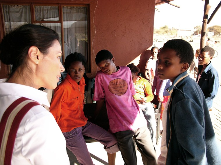 Ann Curry interviews an orphan at Dula Sentle, a community-based orphan care program in Otse village, Botswana, Africa, in July 2005. Curry traveled with first lady Laura Bush to Africa to look at some tough problems facing the continent: AIDS, poverty and genocide.