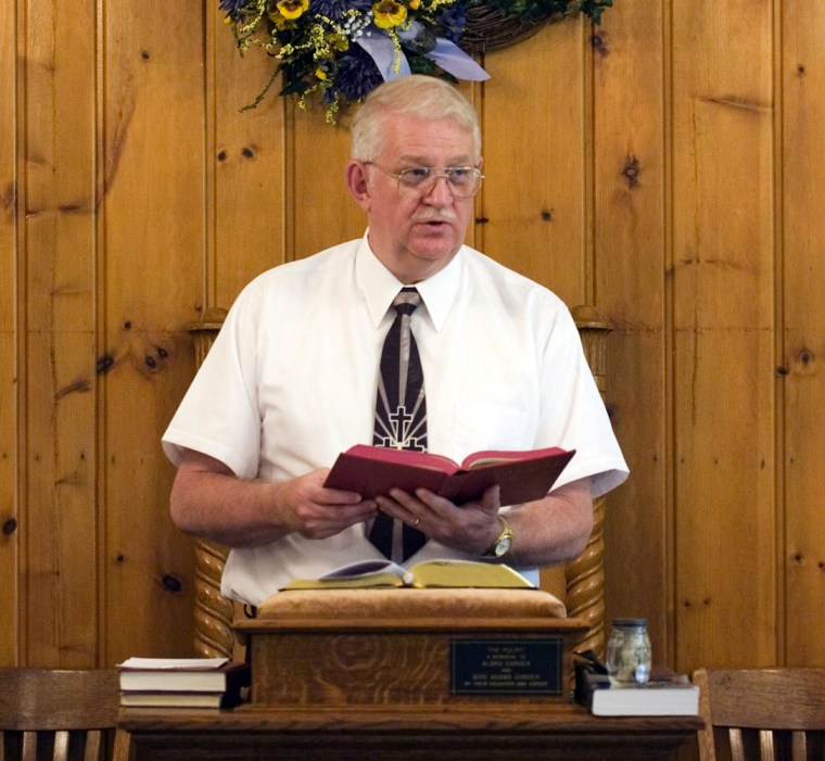 The Rev. Danny Fleming preaches at Big Isaac United Methodist Church in Big Isaac, W.Va. Sunday, May 20. Fleming, a part-time pastor, holds a full-time job with the U.S. Army in Clarksburg, W.Va., while he ministers to two churches some Sundays and three churches on other Sundays.