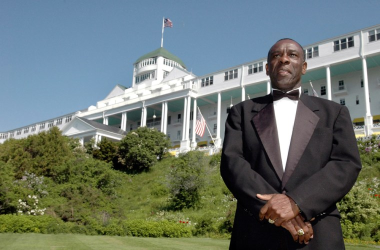 Kenneth Salmon, 52, stands near the Grand Hotel on Mackinac Island in northern Michigan, where over 36 years he has worked his way from the position of busboy to vice president of hospitality. Salmon lives in Montego Bay, Jamaica and returns each summer to oversee the operations of the exclusive hotel.