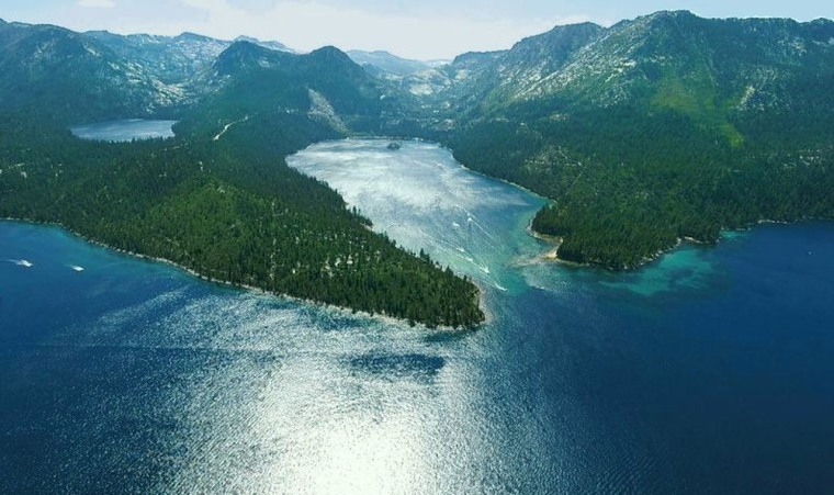 Lake Tahoe, which is shared by California and Nevada, is famed for itsblue water set against green forest.