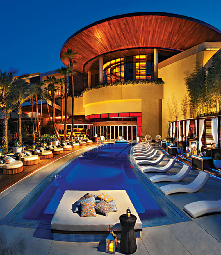 Off the Strip in the Red Rock Casino, Resort and Spa, bar-meister Rande Gerber's recently opened club is decked in sinful shades of red from the tunnel-style entrance to the leather walls. The private outdoor pool area boasts daybeds and cabanas furnished with plasma TVs and private bars.