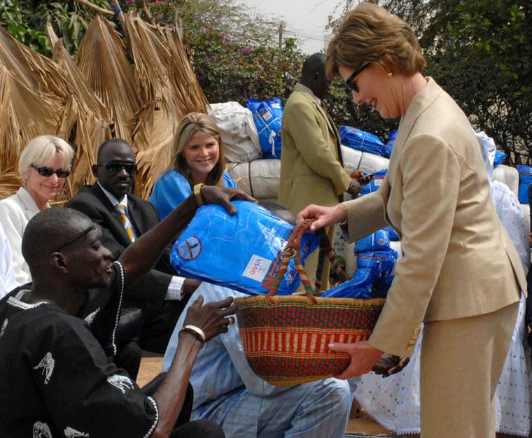 U.S. first lady Laura Bush distributes mosquito nets at the Fann hospital in Dakar