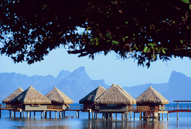 Le Meridien Tahiti, in Tahiti, features 12 Polynesian-style over-water bungalows that stretch out into a turquoise lagoon.