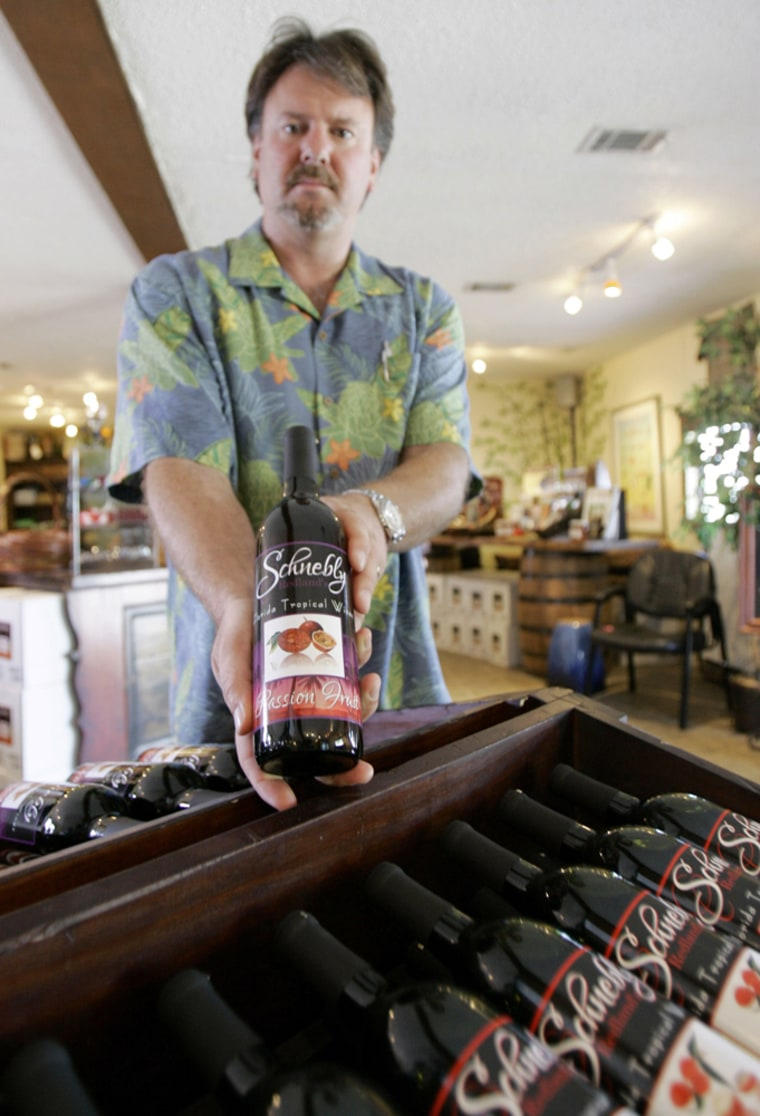 Peter B. Schnebly, owner of Schnebly Redlands Winery, shows one his brand wines in Homestead, Fla. Schnebly and his wife are using wine made from tropical fruit to lure visitors away from the beach to experience other aspects of South Florida's natural beauty.