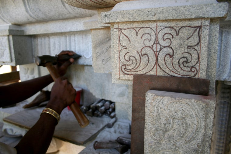 An Indian artisan completes detailed carving on a stone temple to the Hindu god Shiva on the Hawaiian island of Kauai on May 21.