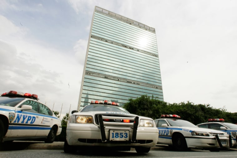 New York City Police Department cars line upin front of the United Nations headquarters Friday. New York strengthened its already tight security as a precaution after car bombs were discovered in London.