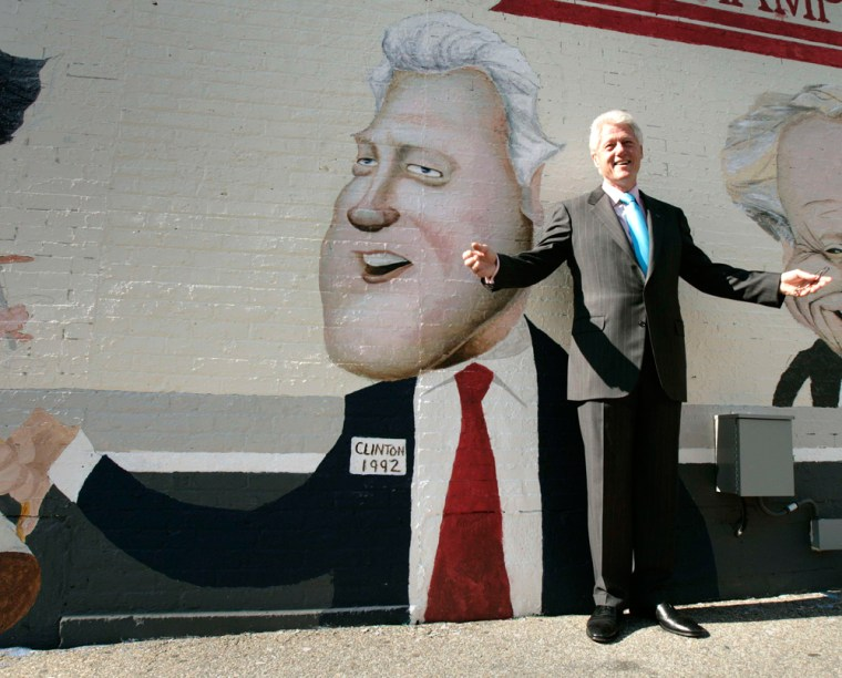 Former US President Bill Clinton poses in Manchester, New Hampshire