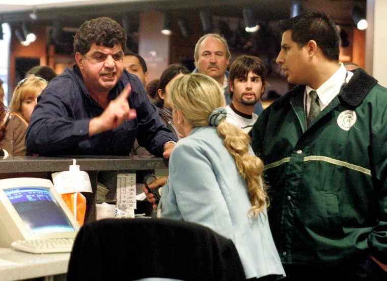 Frustrated passengers protest as flights are delayed at the Buenos Aires domestic airport