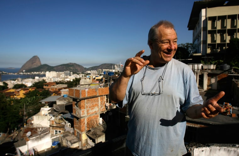 British painter Bob Nadkarni smiles at his home at the Tavares Bastos favela, in Rio de Janeiro, Brazil. One glimpse of the spectacular Sugarloaf mountain view was enough— he decided to build his own home there. Now he rents rooms to visitors and features a monthly Jazz night that attracts scores of outsiders, Brazilian and foreign.