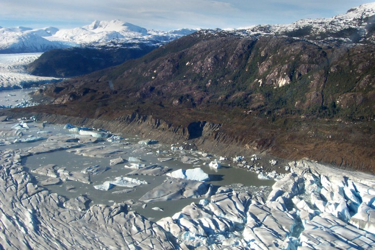 This picture taken Monday shows large pieces of ice and some areas with water at the bottom of a lake in southern Chile. Theglacial lake was discovered dried up in late May.