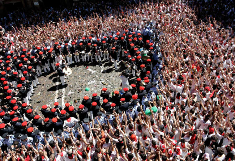 Revellers cheer as municipal band plays at start of San Fermin bull festival in Pamplona