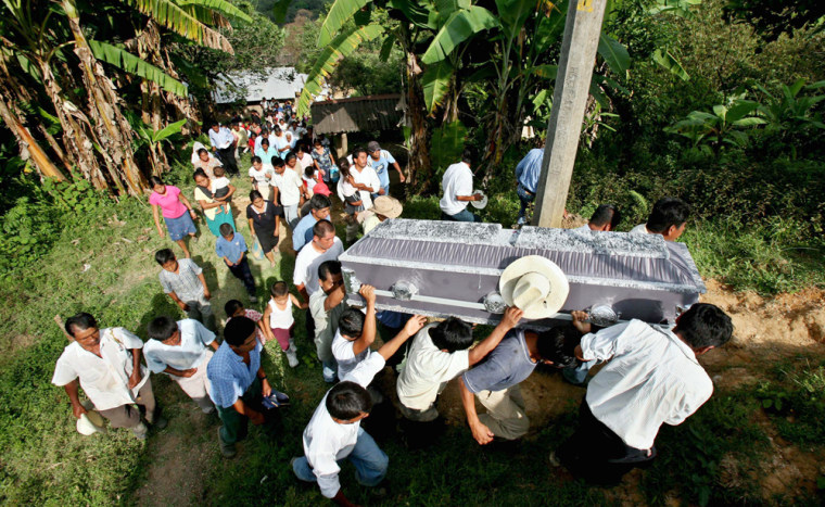 Relatives and friends carry the coffin of Luisa de Jesus Gonzalez, who died in a landslide Wednesday near San Miguel Eloxochitlan, in the village of Cuabtlajapan, central Mexico.