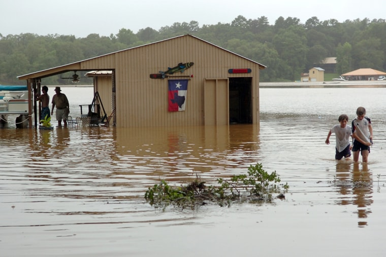 Dick Hightower's boathouse on the north side of Lake Tyler, near Whitehouse, Texas, isflooded Friday as rainstorms pounded Smith County.