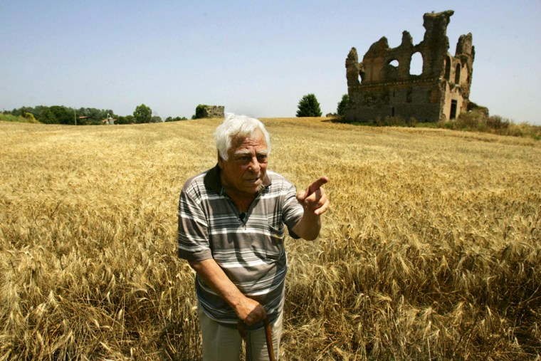 Pietro Casasanta, a 69-year-old convicted looter of antiquities, leans heavily on a cane as he strolls near the ruins of a Roman palace in Anguillara Sabazia.