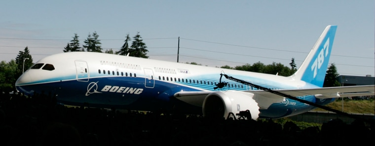 The first production model of the new Boeing 787 Dreamliner airplane is unveiled to an audience of several thousand employees, airline executives, and dignitaries during a ceremony Sunday, July 8, 2007, at Boeing's assembly plant in Everett, Wash.