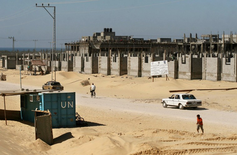 The U.N.'s relief agency said construction has come to a halt on all its building projects in Gaza, including this housing project,because supplies are lacking.