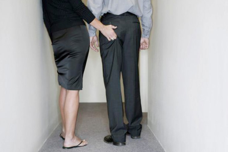Businesswoman Grabbing Man's Buttocks