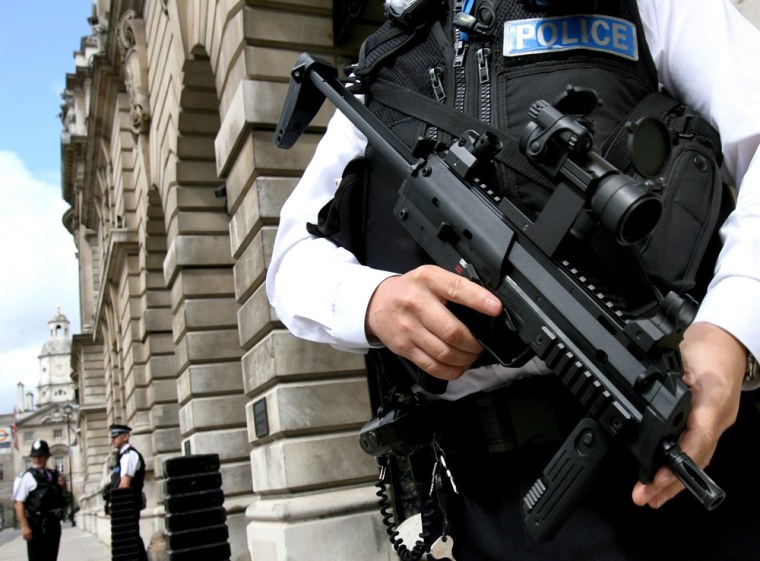 Armed British police guard Whitehall