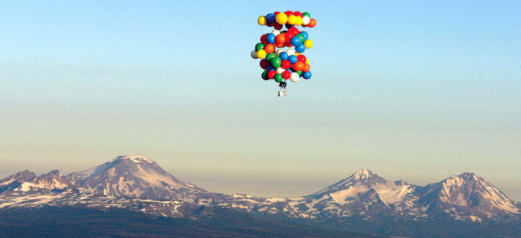 Balloons suspend Kent Couch in a lawn chair as he floats in the skies near Bend, Ore., on Saturday.