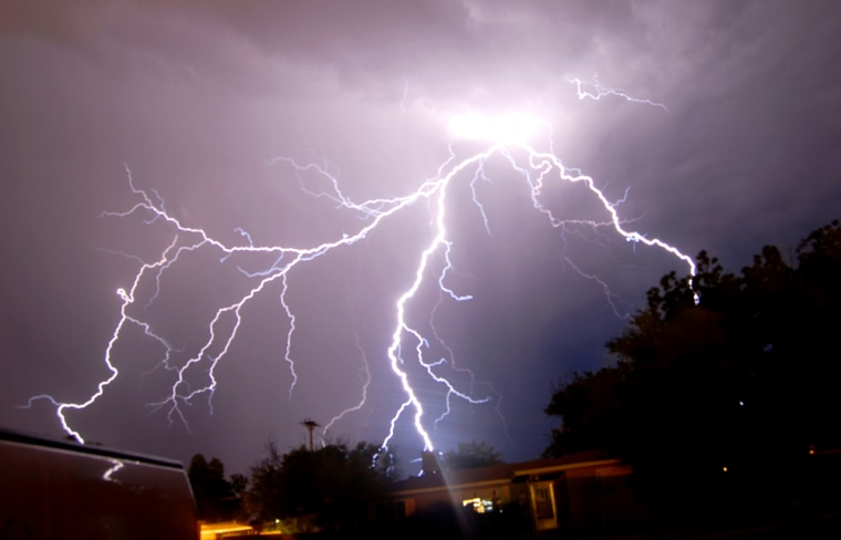 Lightning illuminates the night sky over Roswell, N. M., late Monday, July 2, 2007 as thunderstorms pass through the area. (AP Photo/Roswell Daily Record  Marl Wilson)