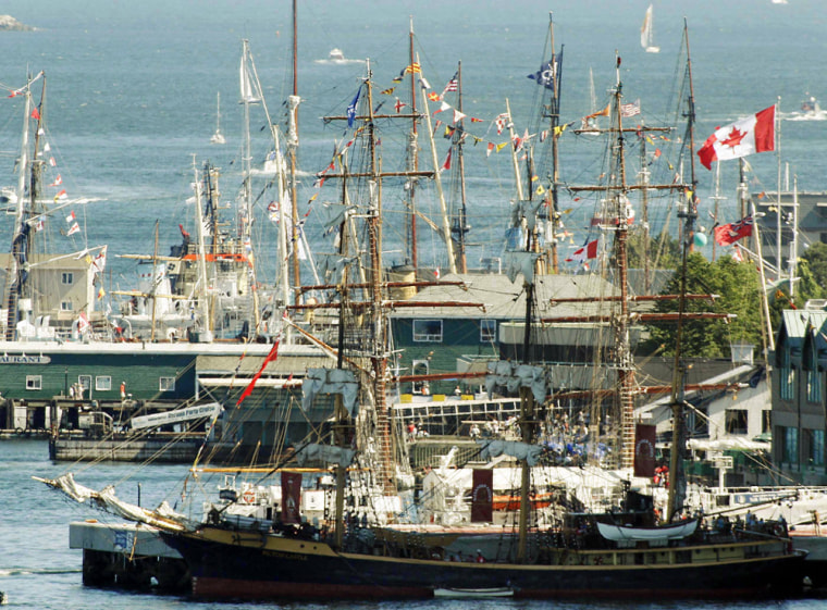 Masts from more than 40 tall ships and schooners fill the skyline along  the waterfront during the second day of the Nova Scotia Tall Ships Festivali in Halifax