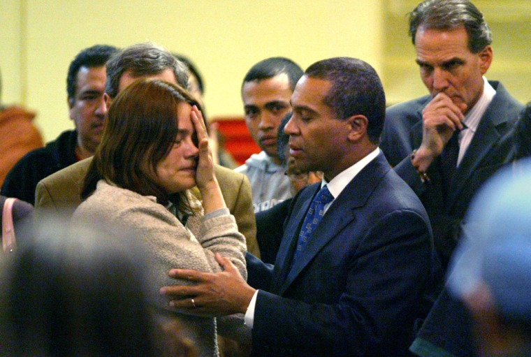 A Honduran woman who gave her name only as Tiadoro is comforted by Massachusetts Gov. Deval Patrick after a rally protesting immigration raids last March in New Bedford, Mass.