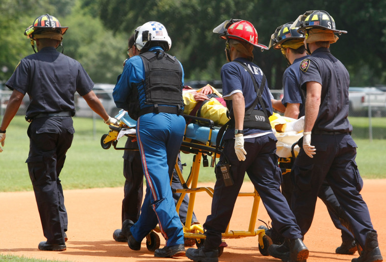San Antonio emergency workers wheel a zookeeper to a helicopter after he was attacked by a male Sumatran tiger at the San Antonio Zoo on Saturday.
