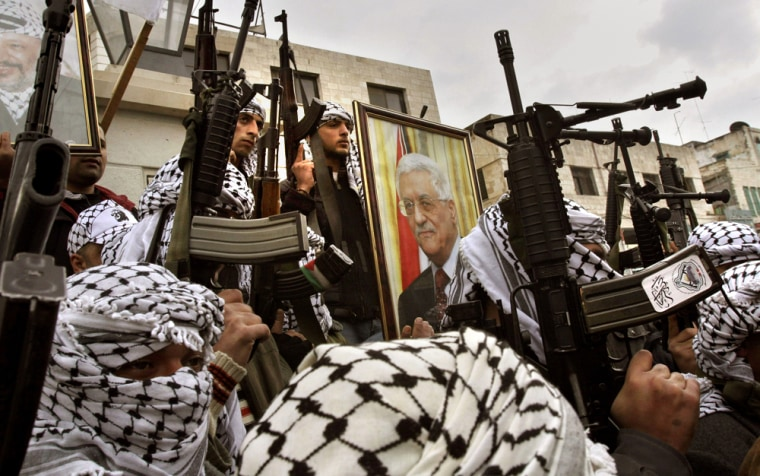 Armed Palestinian militantsfrom a militia linked to the Fatah movement hold posters of Palestinian President Mahmoud Abbas, center, and late Palestinian leader Yasser Arafat, top left, during a march to support Abbas in January.