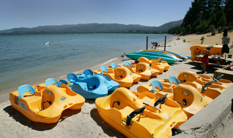 Paddle boats are seen idle on the south shore of Lake Tahoe in South Lake Tahoe, Calif. An unusually dry winter kept ski resorts near Lake Tahoe starved of snow, and wildfires darkened skies on the brink of the summer season, hampering the local tourism industry.
