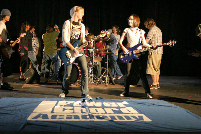 """Power Chord Academy attendees rock out during a session in San Diego last year. """"We immerse the kids in all aspects of music creation,"""" says camp spokesperson Samantha Franklin."""