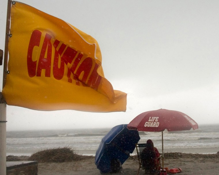A caution flag warns swimmers as wind and rain from Subtropical Storm Andrea invade Dreissen Beach on Hilton Head Island, S. C., Wednesday, May 9, 2007. Andrea formed Wednesday off the southeastern U.S. coast, more than three weeks before the official start of the Atlantic hurricane season, forecasters said. (AP Photo/Gerald Weaver)