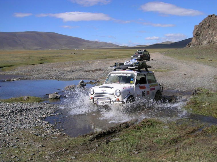 A Mini takes on Mongolian water hazards during the 2005 race.